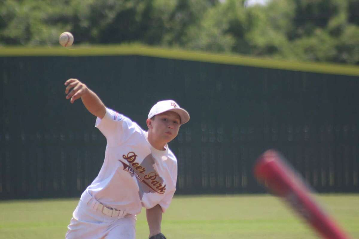 Deer Park's Jackson Charanza battles temperatures in the 90s and the Crosby batters during a Saturday assignment on the hill.