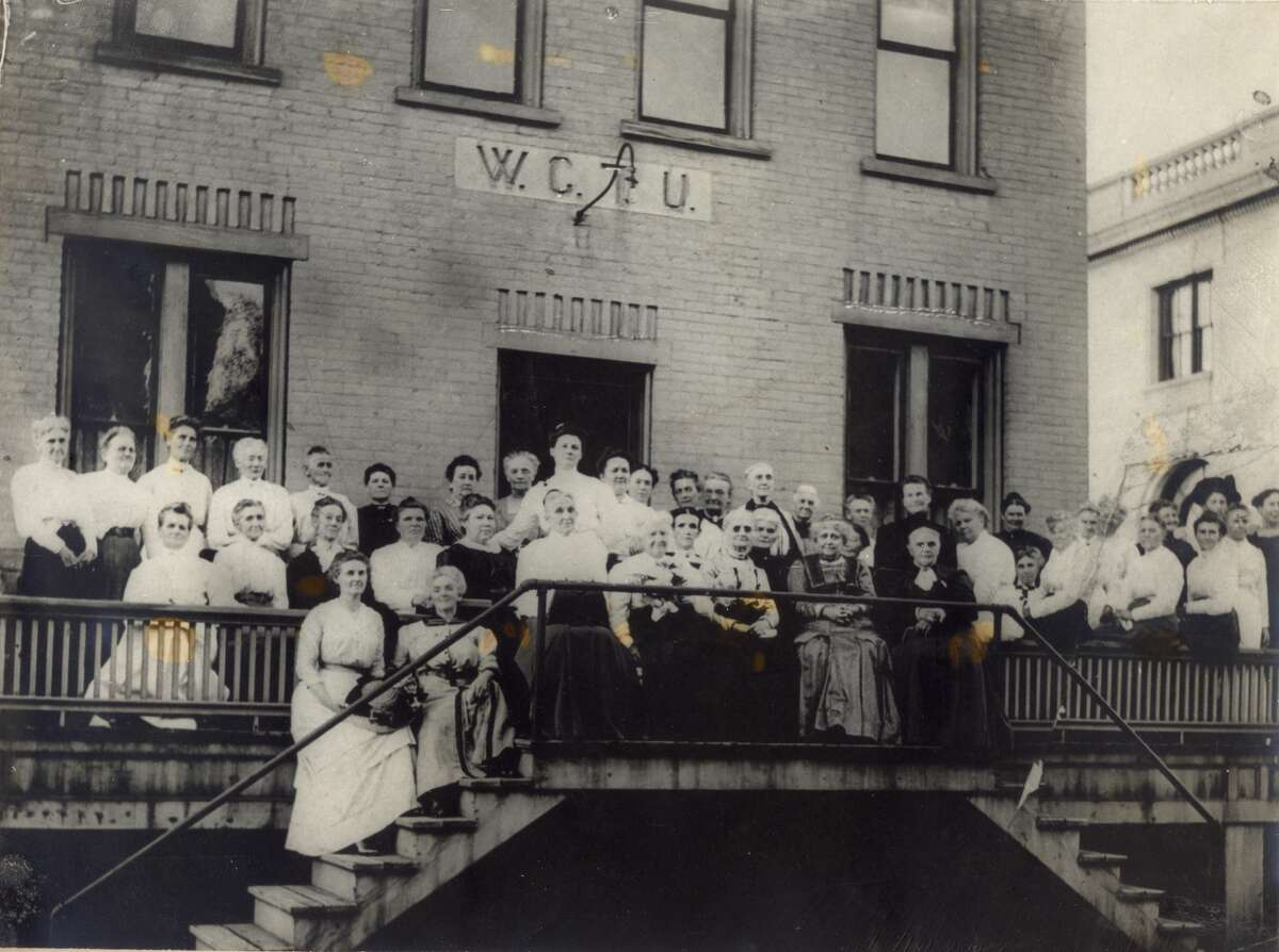 Members of the Women's Christian Temperance Union pose for a photo outside the Union Hall formerly located at 408 Water Street. The organization moved into the Water Street building after their headquarters on the northwest corner of Maple and Water streets was sold and torn down.
