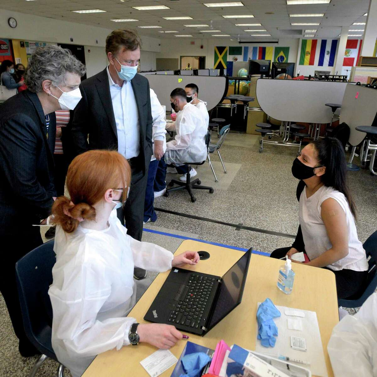 Gov. Ned Lamont visits a vaccination clinic in March 2021 in Danbury, Conn., accompanied by Beth Bye, commissioner for the Connecticut Office of Early Childhood which has been working to expand child-care options for working parents during the COVID-19 pandemic.