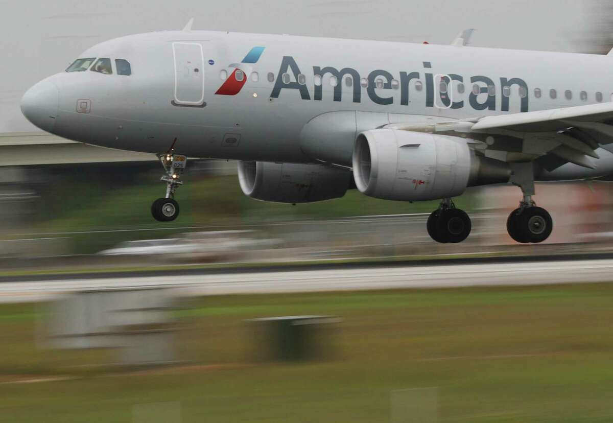 MIAMI, FLORIDA - JUNE 16: An American Airlines plane lands at the Miami International Airport on June 16, 2021 in Miami, Florida. Miami International Airport, founded in 1928, offers more flights to Latin America and the Caribbean than any other U.S. airport, is America's third-busiest airport for international passengers, and is the top U.S. airport for international freight. (Photo by Joe Raedle/Getty Images)