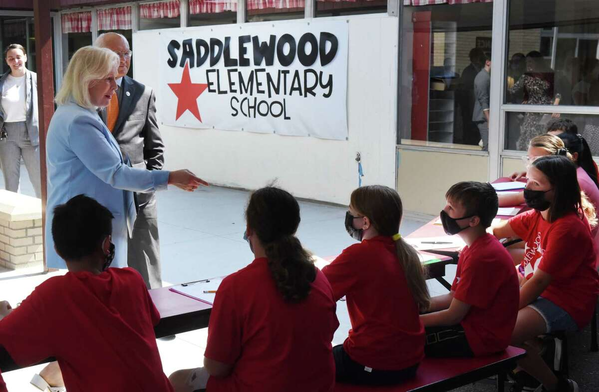 Sen. Kirsten Gillibrand and U.S. Rep. Paul Tonko speak to fourth grade students at Saddlewood Elementary School following a press conference where Sen. Kirsten Gillibrand promoted her newly introduced universal school meals legislation that would provide free school meals for all students on Monday, June 21, 2021, in Colonie, N.Y. Universal School Meals Program Act of 2021 would eliminate school meal debt, encourage the use of local foods in school meal programs and provide free breakfast, lunch, dinner and a snack to all school children regardless of their socioeconomic background. (Will Waldron/Times Union)