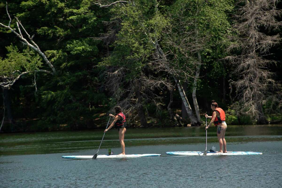 People are seen paddleboarding on the lake at Grafton Lakes State Park on Monday, June 21, 2021 in Grafton, N.Y. (Lori Van Buren/Times Union)