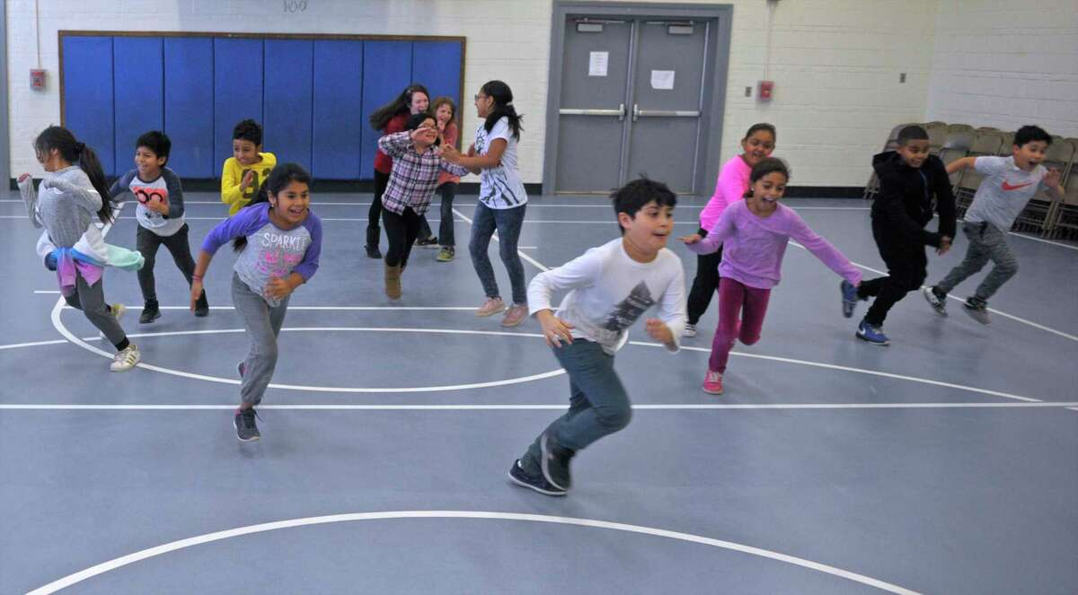 """Students play """"What Time is it Mr. Fox"""" during the Danbury Police Activities League after school program at Morris Street School, in Danbury, Conn, on Wednesday, December 20, 2017."""