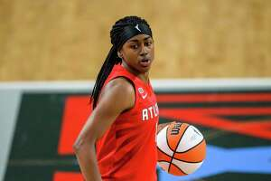 Atlanta Dream guard Tiffany Hayes (15) in action during a WNBA basketball game against the Dallas Wings, Thursday, May 27, 2021, in College Park, Ga. (AP Photo/Danny Karnik)