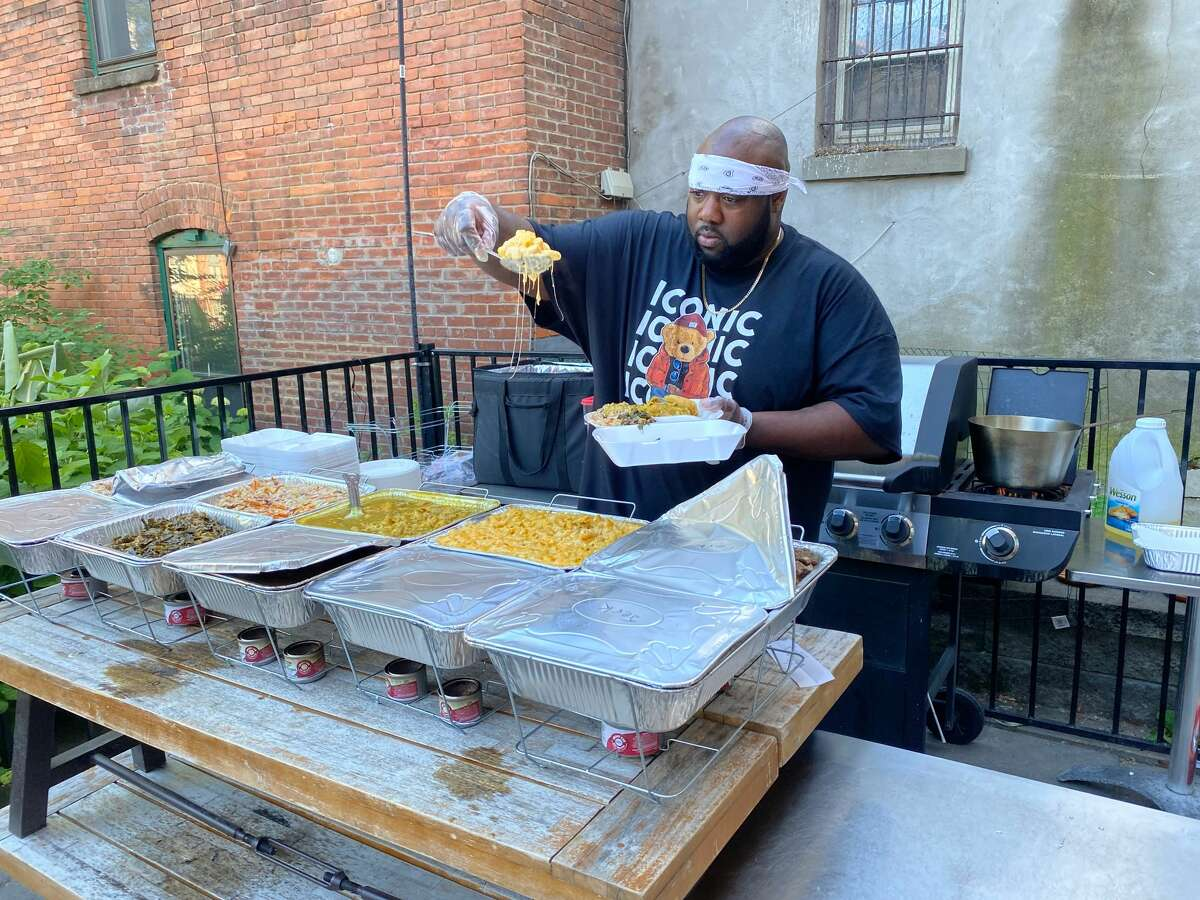 Chef Bjorn Burke dishes up Caribbean fare inspired by his Jamaican grandmother's cooking during Caribbean Soul Sundays at The Night Owl in Saratoga Springs. It is an expansion of a menu offered Wednesday to Saturday nights. (Konrad Odhiambo/for the Times Union.)