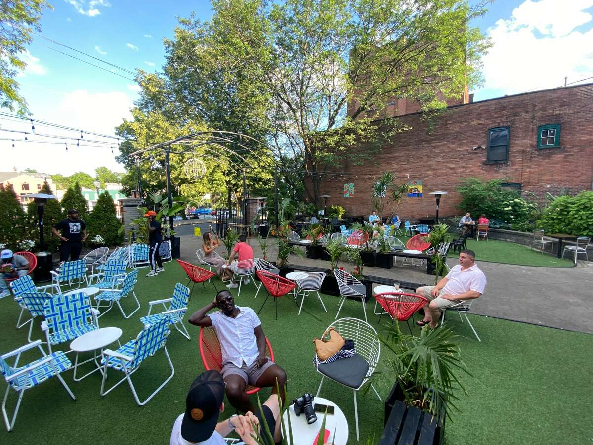Part of the expansive courtyard seating of The Night Owl in Saratoga Springs, where owners of the nightclub are collaborating with Jamaican-born chef Bjorn Burke for a Caribbean menu and vibe. (Konrad Odhiambo/for the Times Union.)