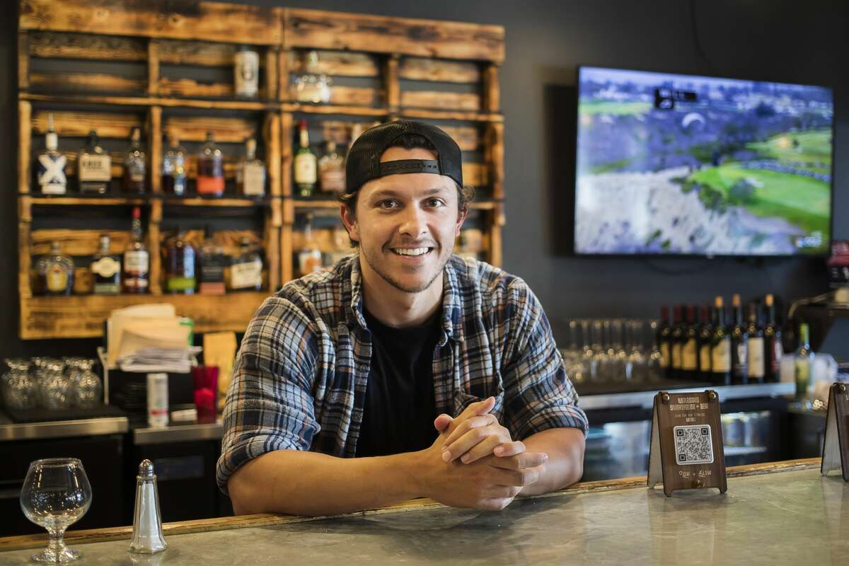 Ryan Mularz, a bartender at Molasses Smokehouse and Bar, poses for a portrait Friday, June 18, 2021 at the restaurant in Midland. (Katy Kildee/kkildee@mdn.net)