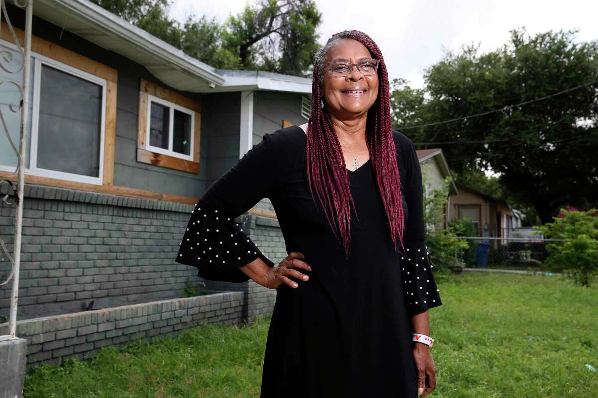 Laura Thompson, president of the African American Network, talks about her collection of San Antonio African American biographies as she stands by her childhood home on the city's Eastside.