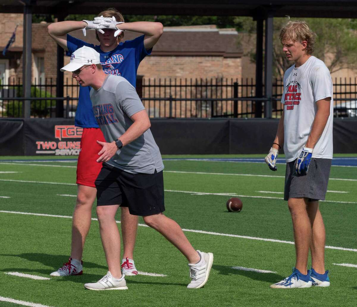 Midland Christian 7-on-7 coach Mason McClendon works with his players 06/21/2021 during MCS 7-on-7 practice. Tim Fischer/Reporter-Telegram