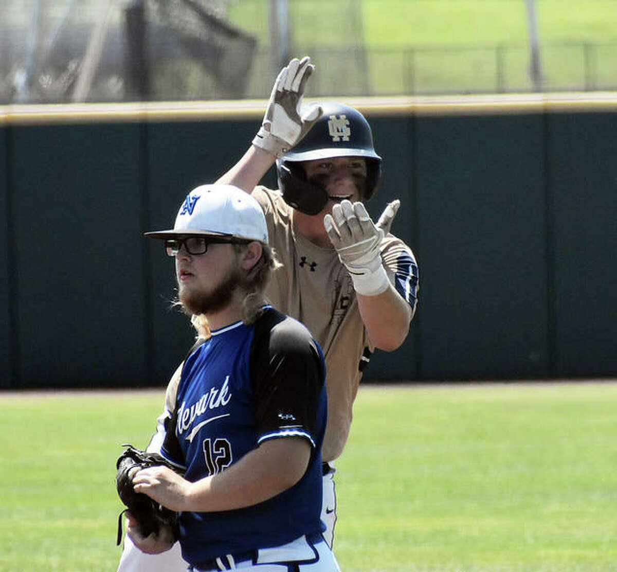 Father McGivney first baseman Gabe Smith celebrates after hitting an RBI single against Newark in the Class 1A state semifinals on Thursday in Normal.