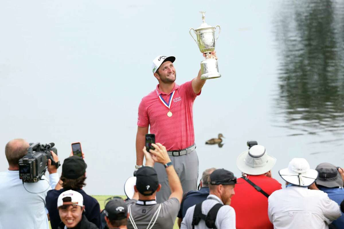 Jon Rahm of Spain celebrates with the trophy after winning the 2021 U.S. Open at Torrey Pines in San Diego.