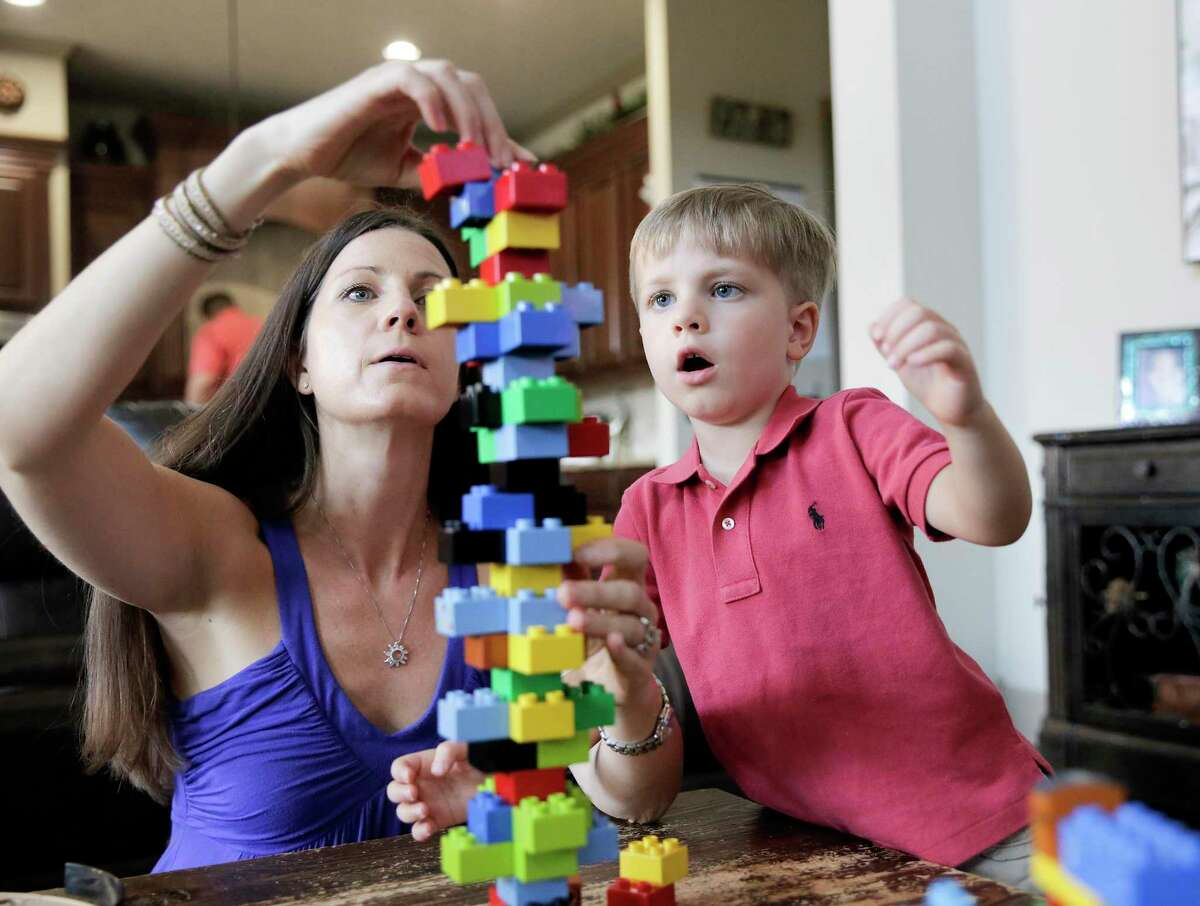 Ann Marie Timmerman plays with her youngest son, Tristan, in their Katy home. Tristan was removed from his parents' care by Child Protective Services after he suffered from a brain bleed. After a 7-month legal battle, CPS dropped the case.