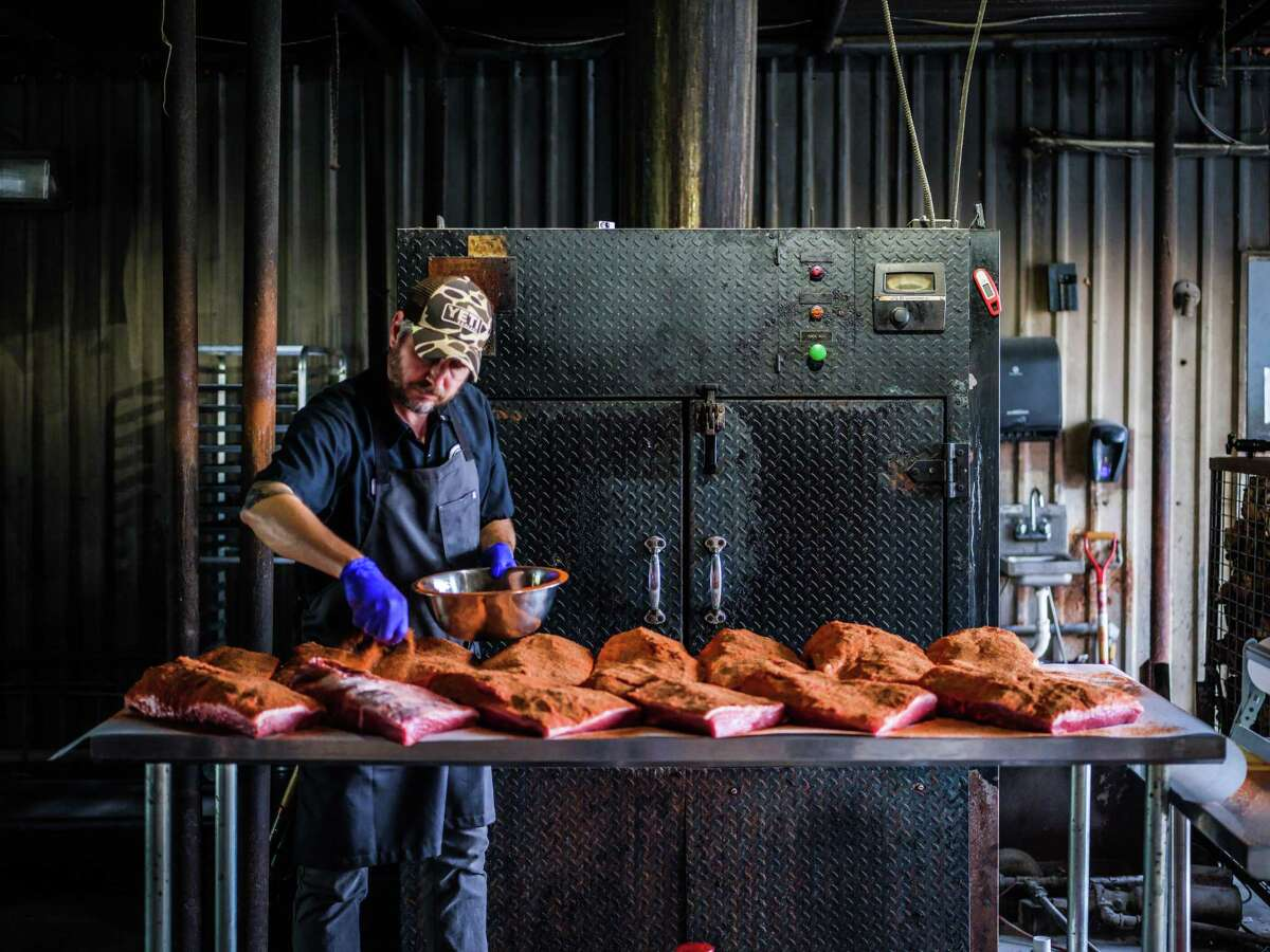 Pitmaster Jim Buchanan seasons signature meats at Dozier's BBQ in Fulshear which is now shipping its barbecue nationally through Williams-Sonoma.