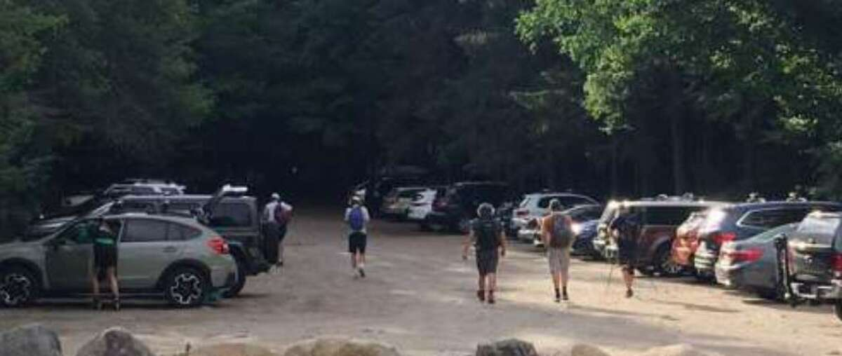 Parking lots near the High Peaks trails fill up quickly, leaving many to scramble for a nearby spot.
