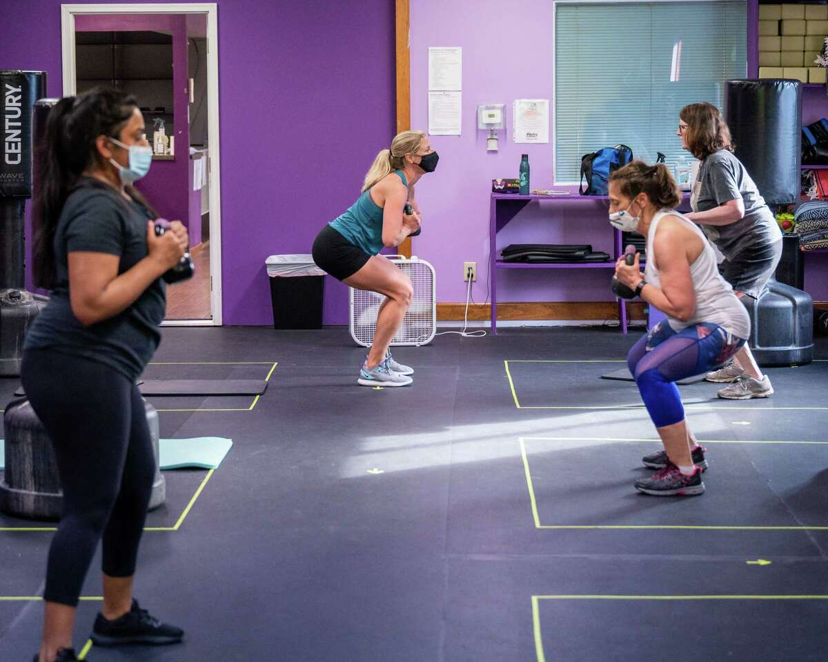 Instructor Kay Williams (center) teaches a class at Girl Fight Fitness in Glenville on Friday, May 21, 2021. The business benefitted from a small business loan from the Town of Glenville that helped keep it afloat. (Jim Franco/Special to the Times Union)