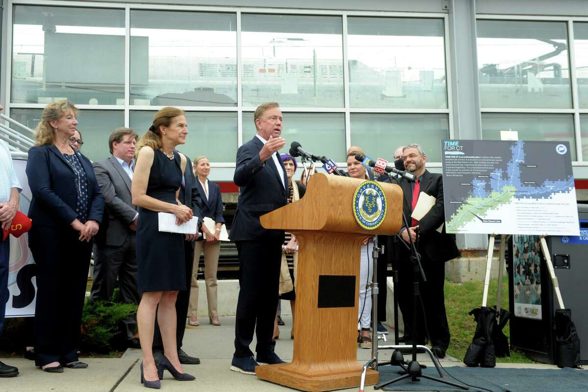 """Governor Ned Lamont speaks during a news conference at the Stratford rail station, in Stratford on Monday. Lamont was joined by other federal, state and local leaders to announce """"Time for CT"""", an new plan to improve passenger and commuter rail service in Connecticut."""