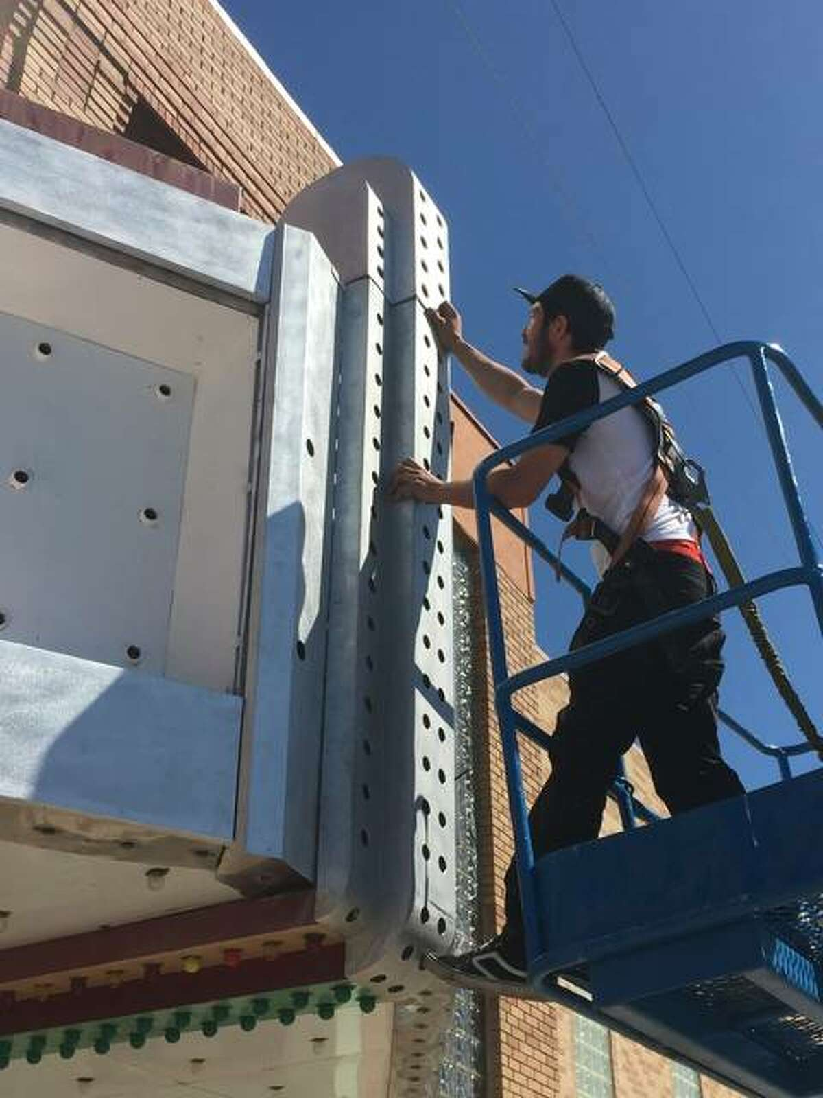 Chris Staar, owner of NeonWorks Inc. of East Alton, works on The Stadium Theatre marquee restoration in Jerseryville during the start of May. Opened in 1949, the Jerseyville movie theater will host a ribbon cutting on Thursday night in honor of its upgrades.