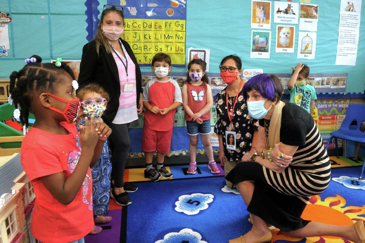 U.S. Rep. Rosa DeLauro, right, meets with students and their teachers in a classroom at TEAM's early education program in the Margaret Egan Center, in Milford, Conn. June 21, 2021. DeLauro spoke at the center to promote child tax credit awareness.