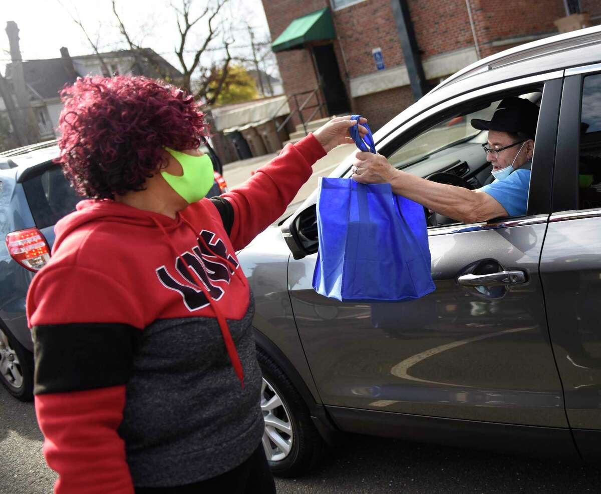 Turkeys are distributed at Bethel AME Church in Stamford, Conn. Wednesday, Nov. 25, 2020.