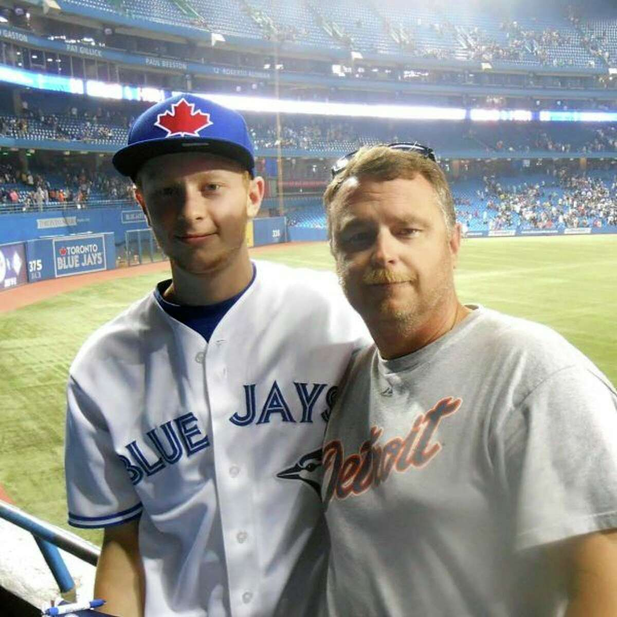 A photo ofme with my dad at a Blue Jays-Tigers game during our first trip to Toronto in the summer of 2013. (Courtesy photo)