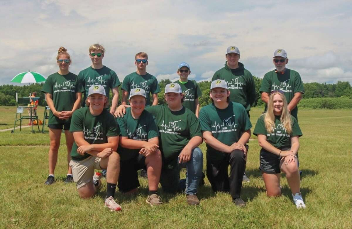 Members of Dow High's trapshooting team are (front, from left) Bailey Cole, Carson May, Jacob Chisholm, Greg Farnum, Alex Little; and (back, from left) Kaylee Jackson, Nathan Witt, Austin Keskey, Noah Kesler, Jack Coppens, and coach Tim Chisholm.