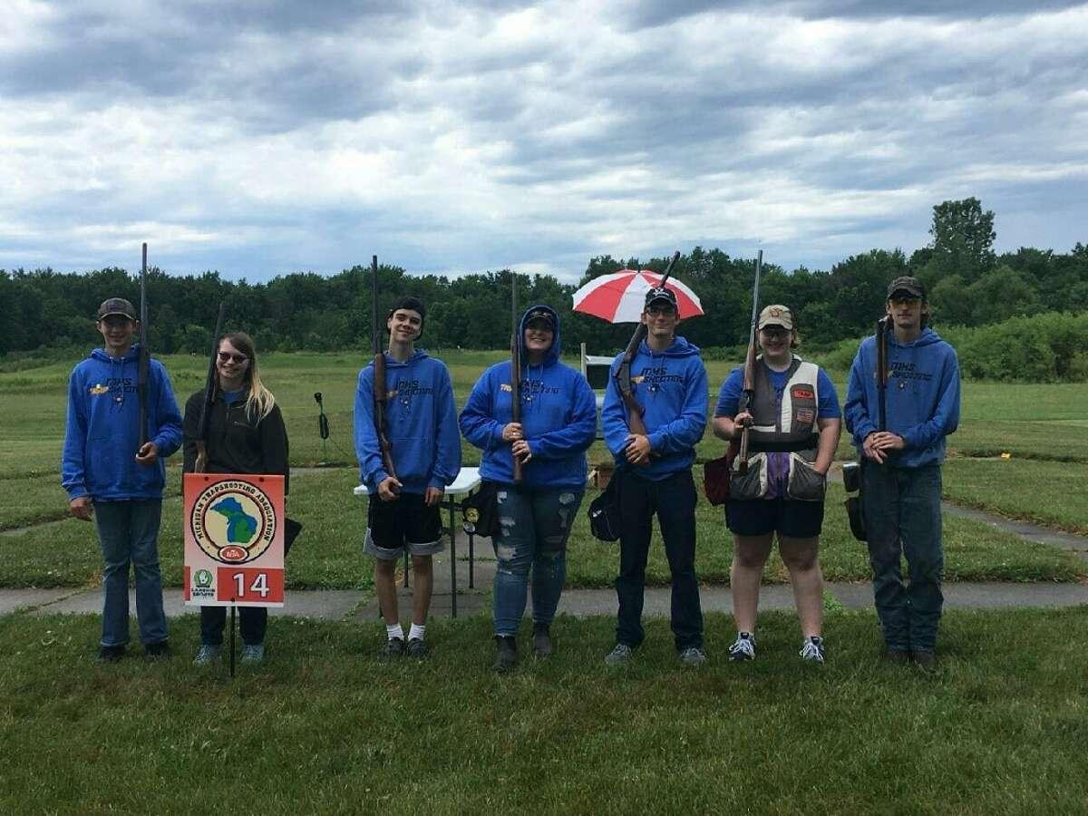 Members of Midland High's trapshooting team are (from left) Ryan Ludwig, Lea Houghtaling, Ben Thomas, Dani Winslow, Hunter Buczek, Marissa Berghuis, and Gavin Gilmore.