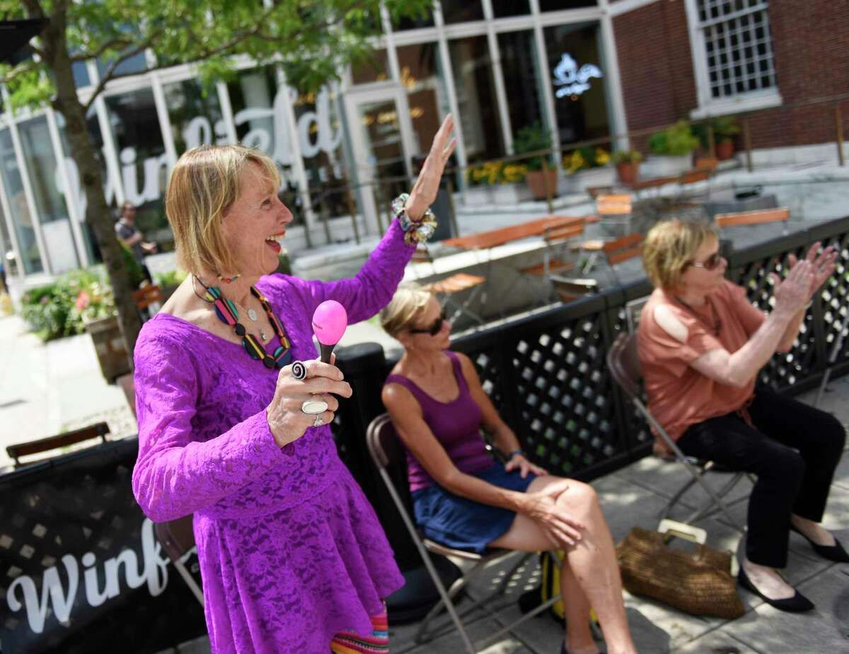 Stamford resident Judy Stewart dances along to music by Barbara Espinosa Occhino as part of the Stamford Downtown Make Music Day at the Ferguson Library plaza in Stamford on Monday. The fourth annual Stamford Downtown Make Music Day featured a mix of 27 free outdoor musical events throughout the city at venues, including Latham Park, Mill River Park, Columbus Park, Old Town Hall, Ferguson Library Plaza and Stamford URBY. The performances in Stamford are part of a larger global celebration that is held on the summer solstice in more than 1,000 cities in 120 countries.