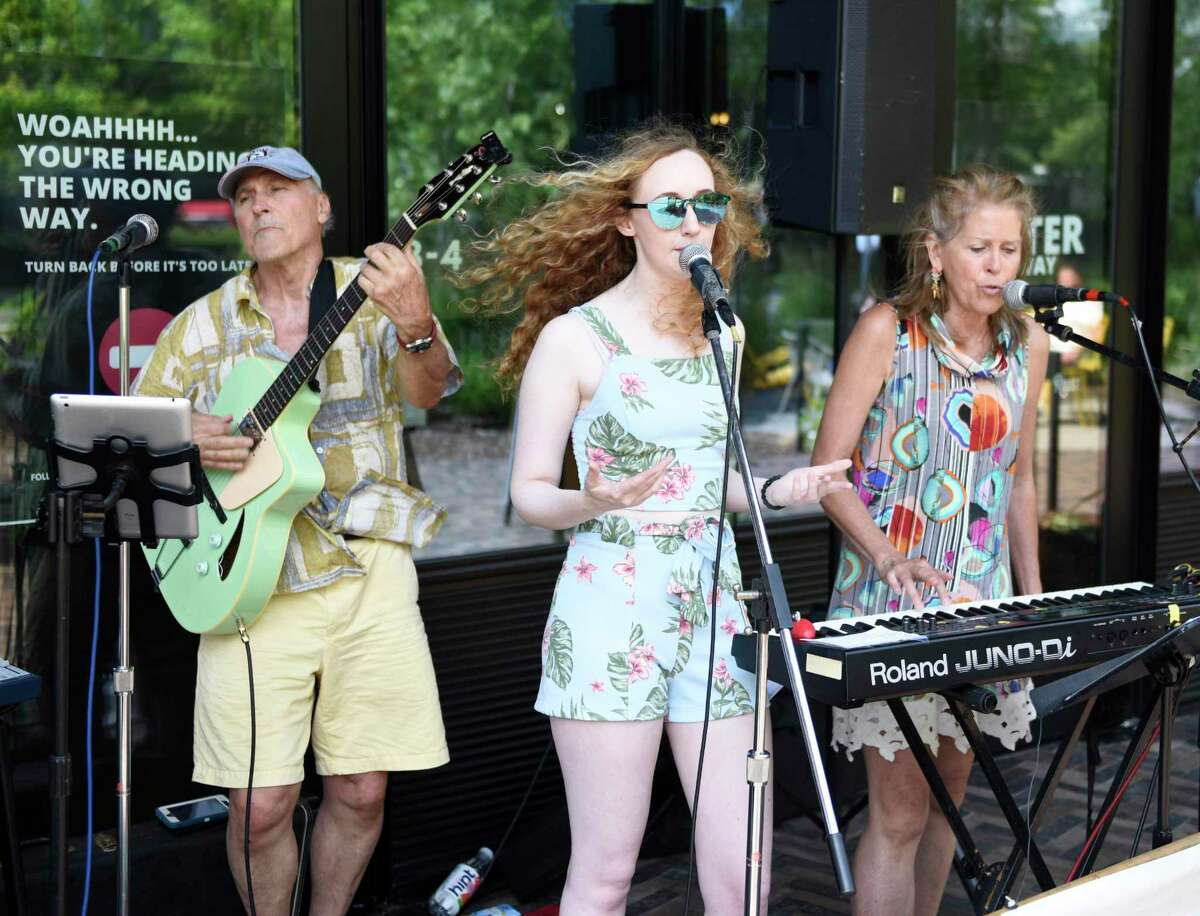 The Exit 5 band consisting of John Motay, left, Marycate Muller, center, and Laura Kaehler performs as part of the Stamford Downtown Make Music Day at URBY in Stamford, Conn. Monday, June 21, 2021. The fourth annual Stamford Downtown Make Music Day featured a mix of 27 free outdoor musical events throughout the city at venues including Latham Park, Mill River Park, Columbus Park, Old Town Hall, Ferguson Library Plaza and Stamford URBY. The performances in Stamford are part of a larger global celebration that is held on the summer solstice in more than 1,000 cities in 120 countries.