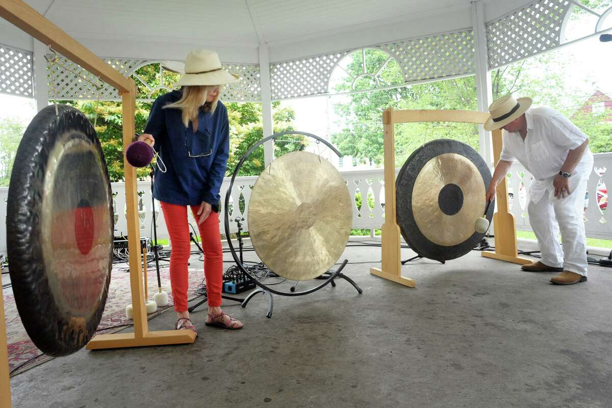 Husband and wife Chris Frantz and Tina Weymouth, of Fairfield, ring a set of gongs to kick off Make Music Day at the gazebo on Sherman Green, in Fairfield, Conn. June 21, 2021. Frantz and Weymouth are members of Talking Heads and Tom Tom Club. Make Music Day is an international festival marking the summer solstice.