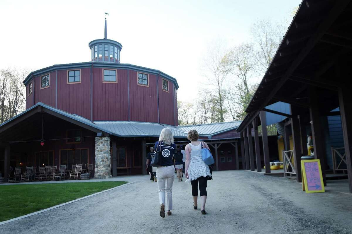 ADVANCE FOR THE WEEKEND OF DEC. 5-6 AND THEREAFTER - In a May 7, 2015 photo, Amanda Garbatini, right,a staffer at the Hole In The Wall organization, walks with her mother, Lace Garbatini, during an event at the Hole In The Wall Camp recently in Ashford, Ct. Amanda is a cancer survivor. She lost a leg to cancer at age 13, a rib shortly after and now, at 28, has had a double mastectomy this past summer. Despite it all, she is competing in marathons, rock climbing and is always positive about her life. (Stephen Dunn/Hartford Courant via AP) MANDATORY CREDIT