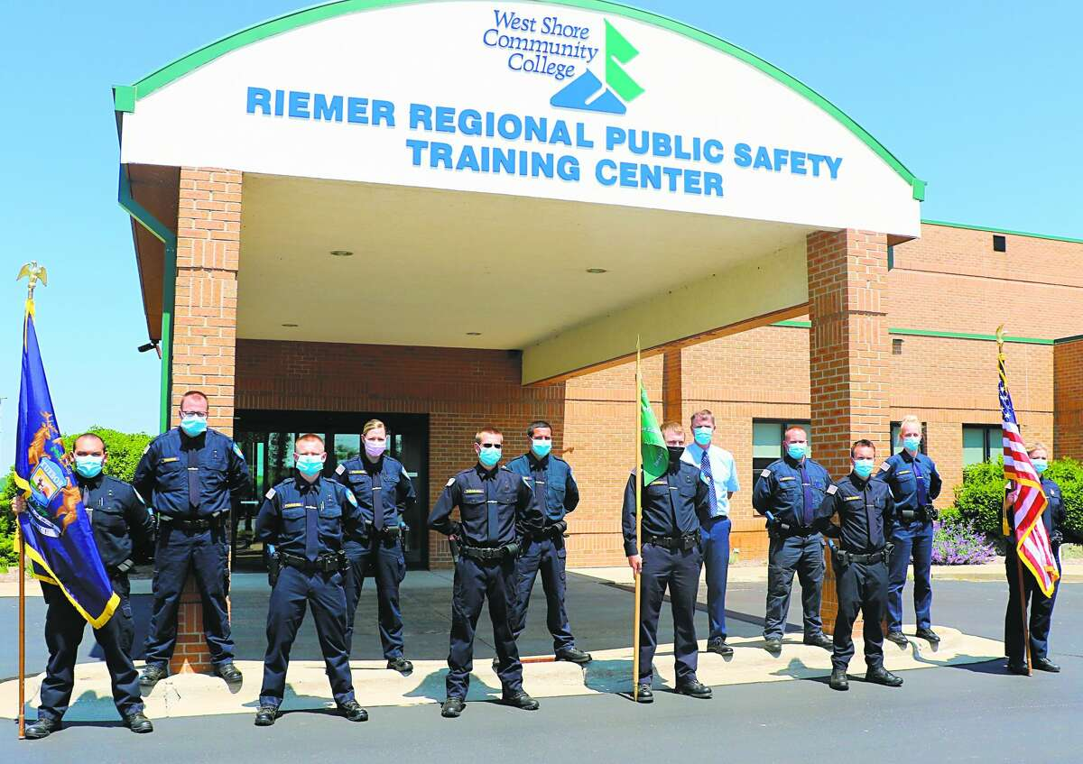 The 2020 West Shore Community College Police Academy graduates stand in front of the Riemer Regional Public Safety Training Center following their graduation. The class had to overcome many obstacles on the way to graduation due to the COVID-19 pandemic.