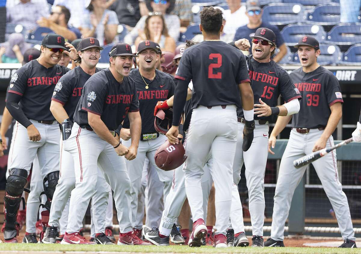 Stanford players celebrate as Tommy Troy, obscured behind Drew Bowser (2), returns to the dugout after hitting a two-run home run against Arizona in the third inning during a baseball game in the College World Series Monday, June 21, 2021, at TD Ameritrade Park in Omaha, Neb. (AP Photo/Rebecca S. Gratz)