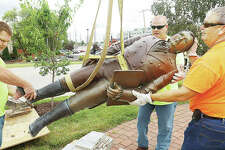Edwardsville Public Works employees swing the controversial statue of Ninian Edwards around after cutting it loose from its pedestal. The statue was a focal point for the Our Edwardsville movement that rallied against the likeness of first territorial governor in the early 1800s because he owned slaves and supported slavery.