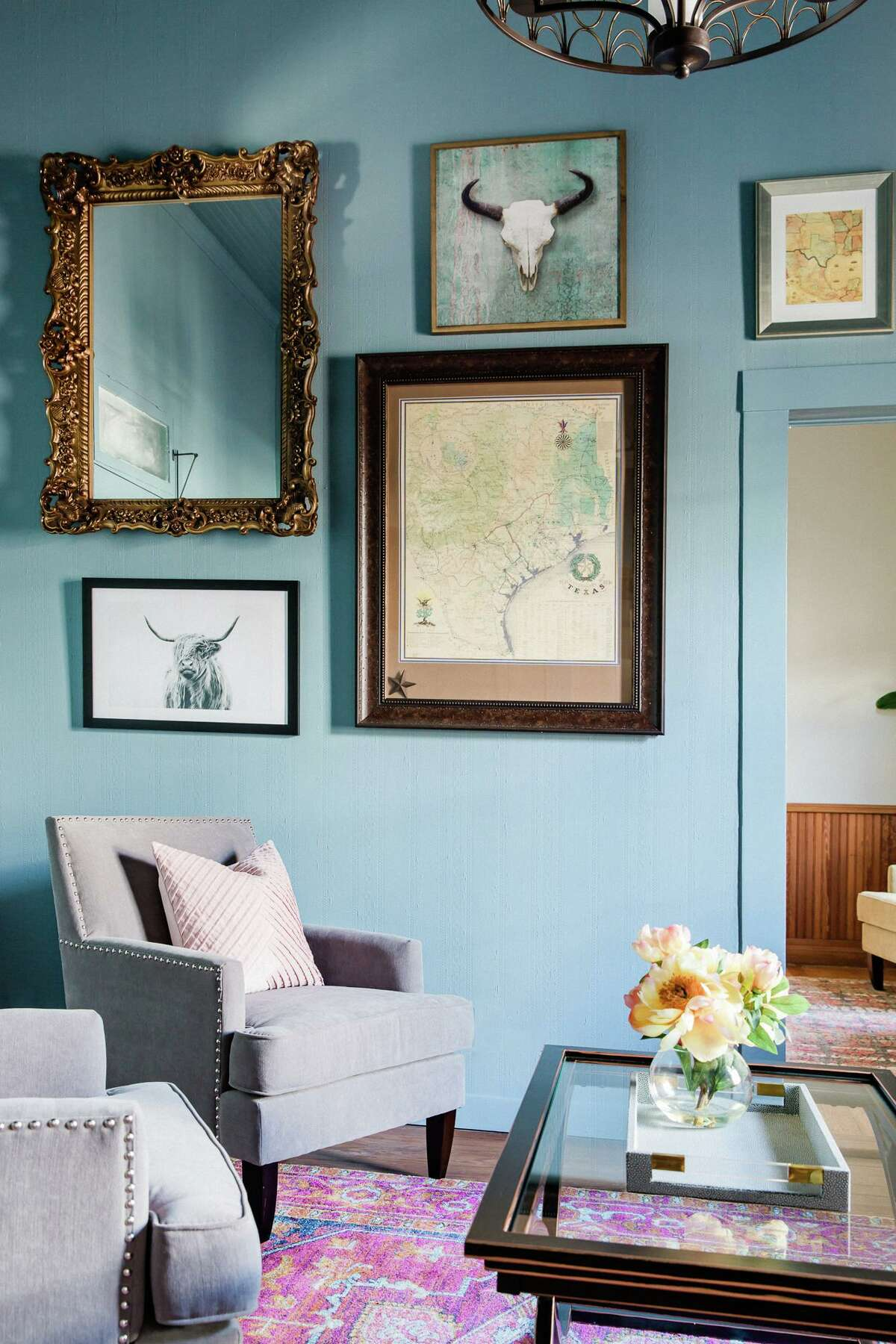 A homeowner was certain that an ornate frame wouldn't work with her desire for a more contemporary home. Interior Designer Victoria Sheffield mixed it with photography and art for an eclectic-style gallery wall.