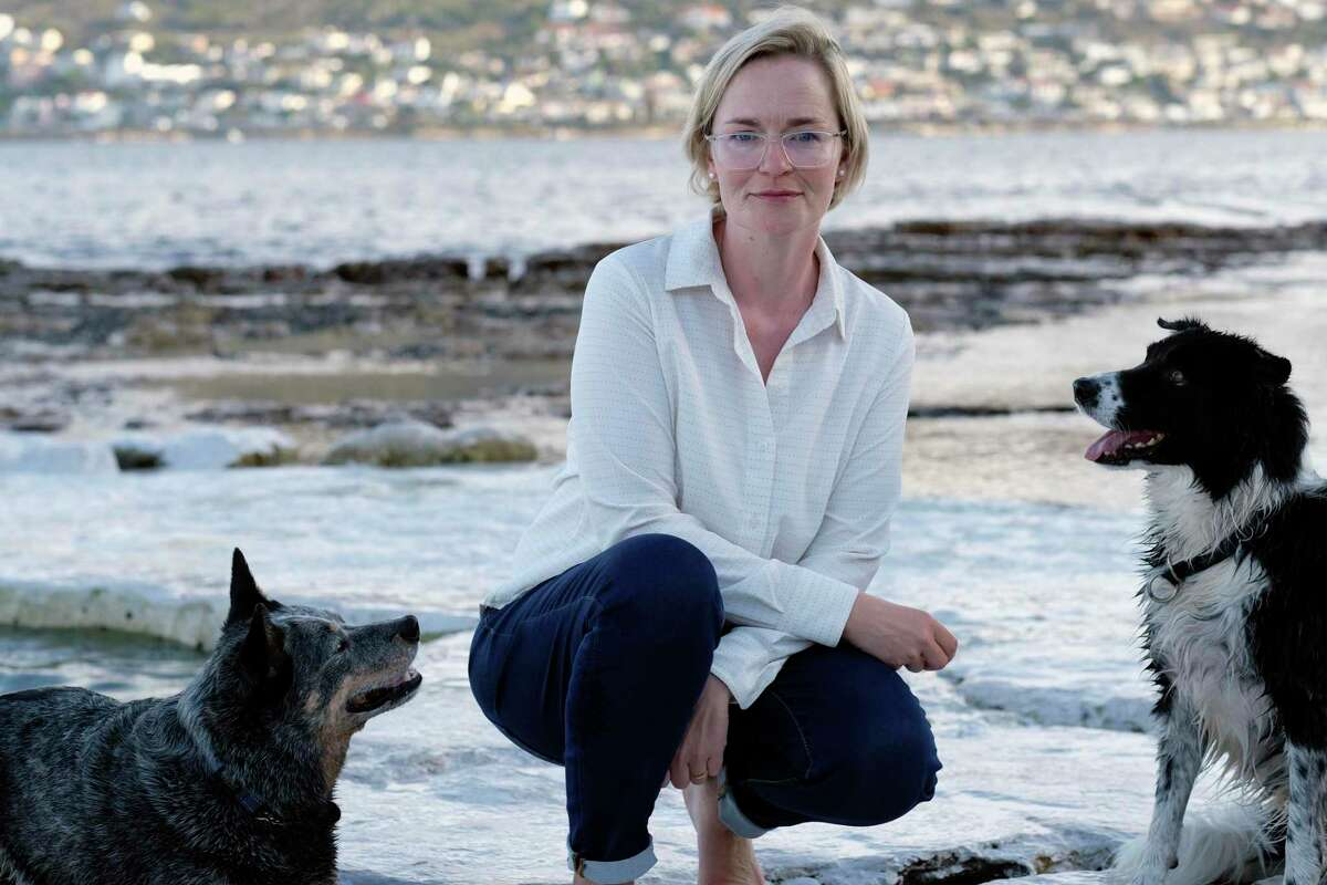 Pet custody specialist Karis Nafte, shown with her dogs Sam, left, and Jax in Cape Town, South Africa, helps couples settle disputes over their pets as more states move to make it easier for judges to consider the best interests of companion animals in divorce.