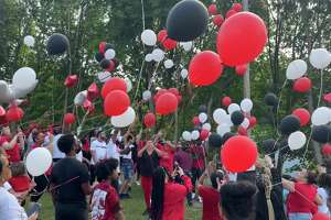 DANBURY, Conn. — Balloons rise over the Joseph Sauer Memorial Park on Beaver Street during a memorial service for Yhameek Johnson on Monday, June 21, 2021. Police said the 18-year-old was killed in a drive by shooting the night before.