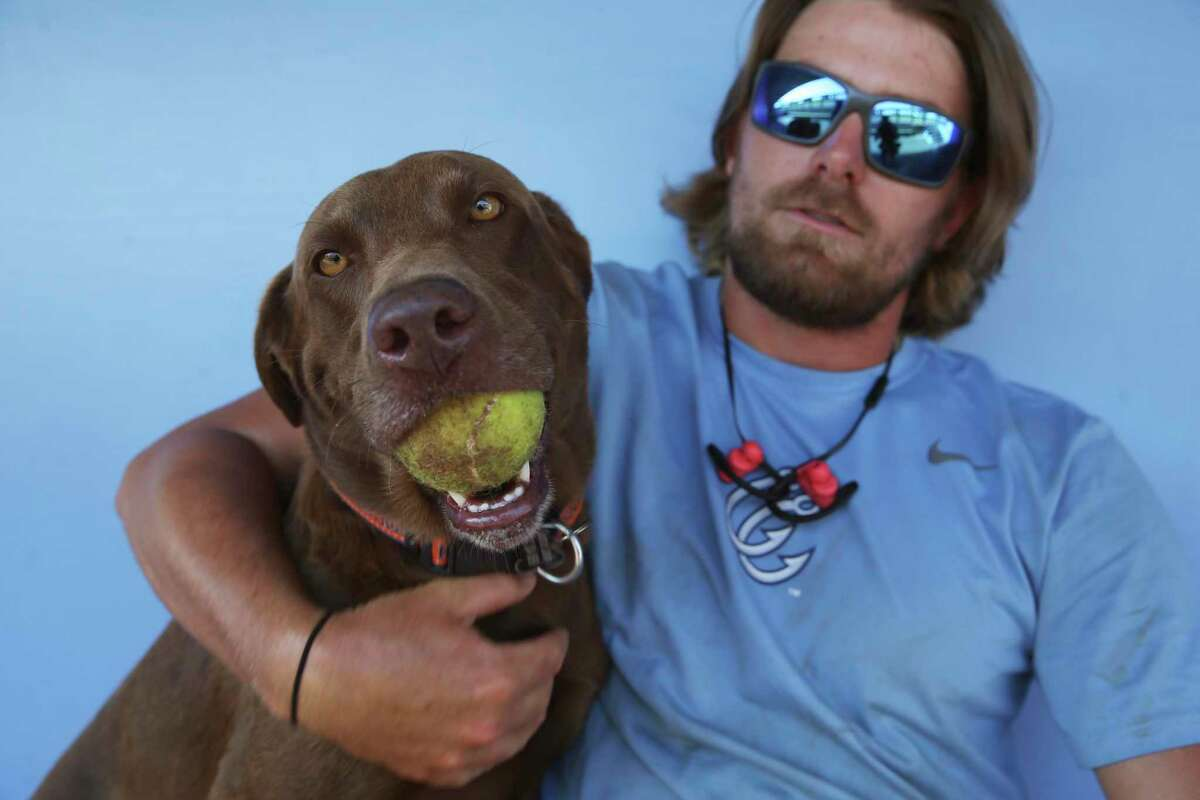 Quince Landry, the head groundskeeper for the Hooks, bought teal is a bird-hunting dog in Louisiana.