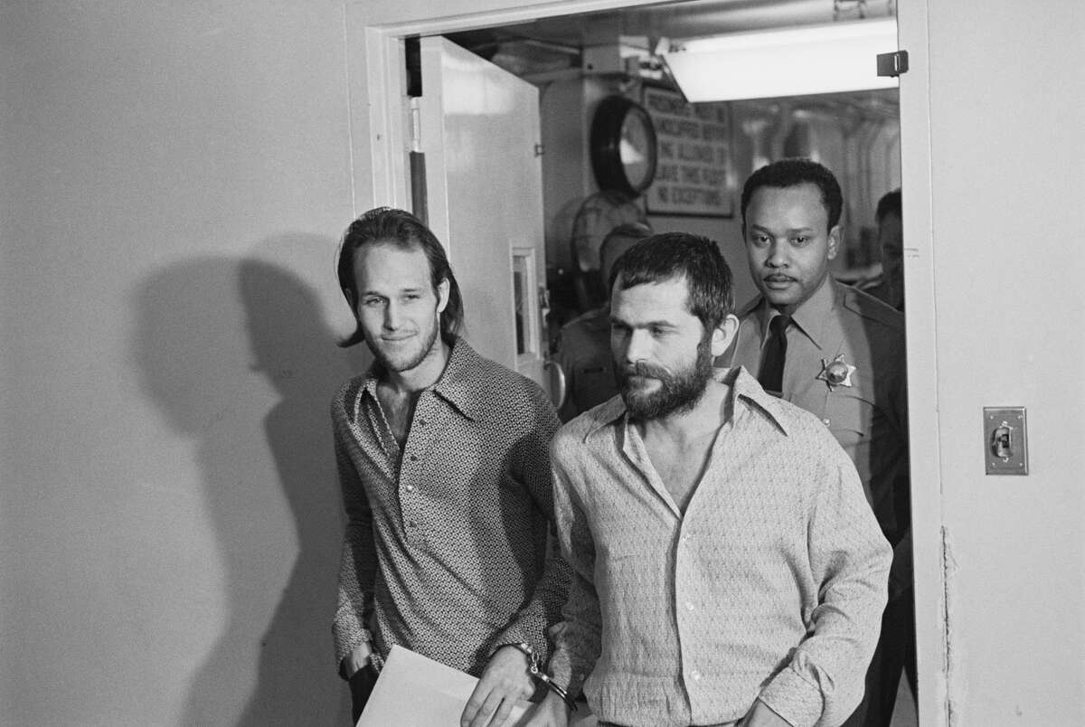 Steve Grogan (left) and Bruce Davis (right), defendants in the murder of movie stunt man, Donald (Shorty) Shea are taken into court. Davis, along with Charles Manson (not present) was accused of both the Gary Hinman and Shea murders, while Grogan was a defendant in the Shea case only.