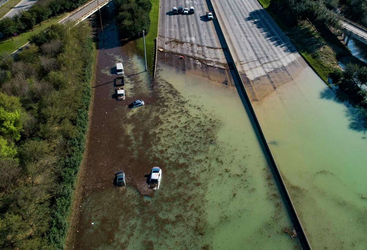 Water is slowly draining from the freeway after a water main break east of the location flooded all lanes, closing the freeway in both directions, Thursday, Feb. 27, 2020, at the intersection of 610 and Clinton Drive in east Houston.