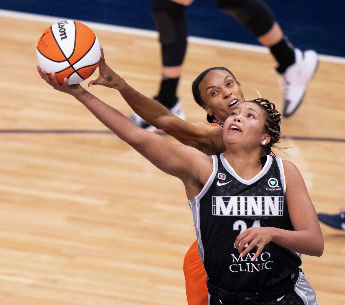 Minnesota Lynx forward Napheesa Collier (24) was fouled by Connecticut Sun forward/guard DeWanna Bonner in the second quarter during a game in May.