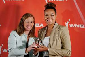 Minneapolis, MN-September 16: Napheesa Collier of the Lynx who was named WNBA Rookie of the Year posed for a photo with WNBA Commissioner Cathy Engelbert. (Photo by Richard Tsong-Taatarii/Star Tribune via Getty Images)