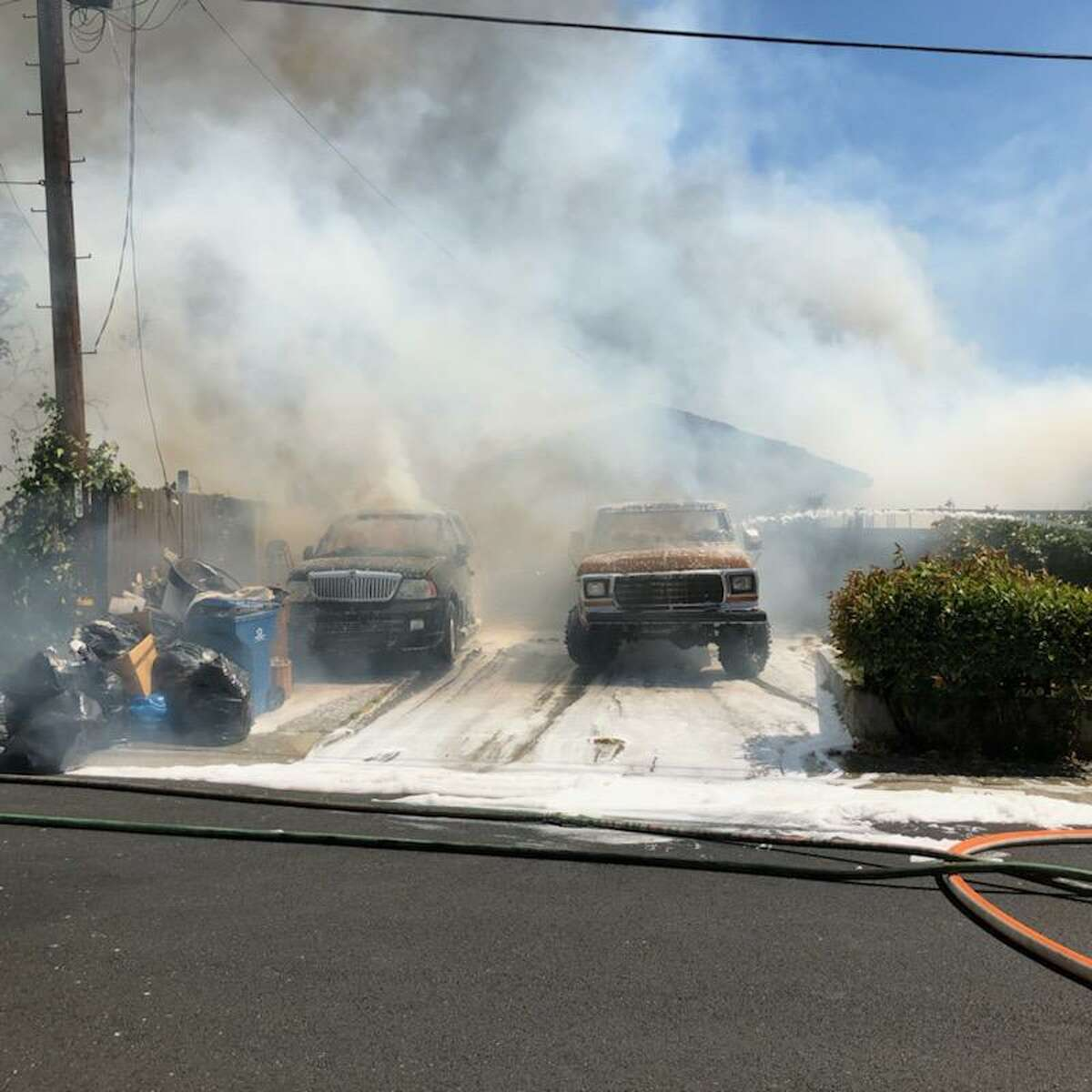 Firefighters from the Contra Costa County Fire Protection District battled a fire that burned two homes in Pleasant Hill on Monday, June 21, 2021.