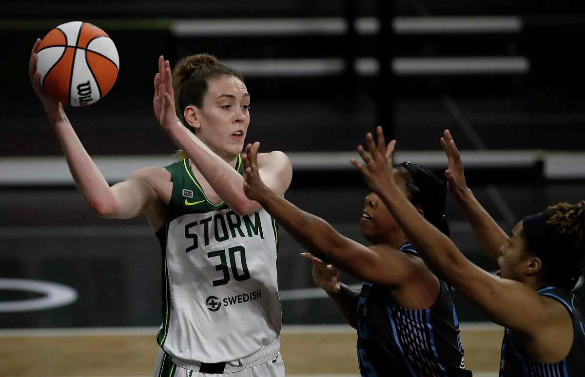 Seattle Storm forward Breanna Stewart looks to pass away from the Atlanta Dream during the first half of an WNBA basketball game Friday, June 11, 2021, in College Park, Ga. (AP Photo/Ben Margot)
