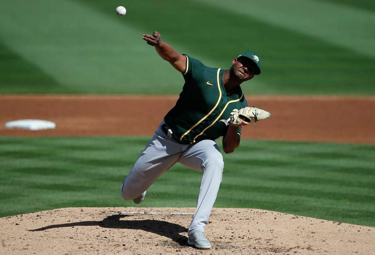SCOTTSDALE, ARIZONA - MARCH 16: Domingo Acevedo #68 of the Oakland Athletics delivers a pitch to the Arizona Diamondbacks during the third inning of the MLB spring training baseball game at Salt River Fields at Talking Stick on March 16, 2021 in Scottsdale, Arizona.