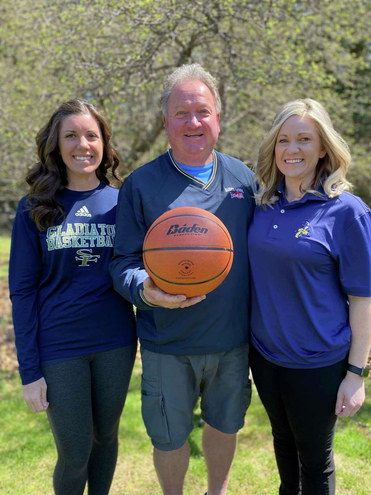Manistee Catholic Central coach Todd Erickson and his daughters, Kelly (left) and Katie (right), are all involved in girls basketball varsity programs. (Courtesy photo)
