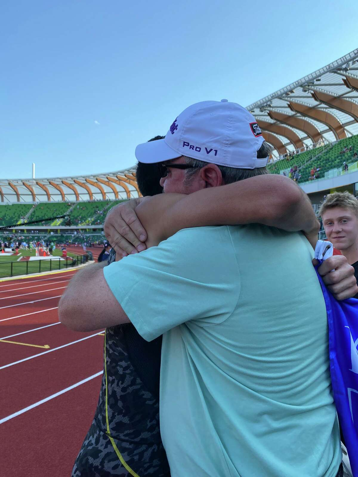 Bryce Hoppel, left, gives Jeff Streuna hug after he qualified for the Tokyo Olympics with a third-place finish in the 800-meter final at the U.S. Olympic Team Trials, June 21 in Eugene Oregon. Streunwas Hoppel's track & field coach at Midland High.