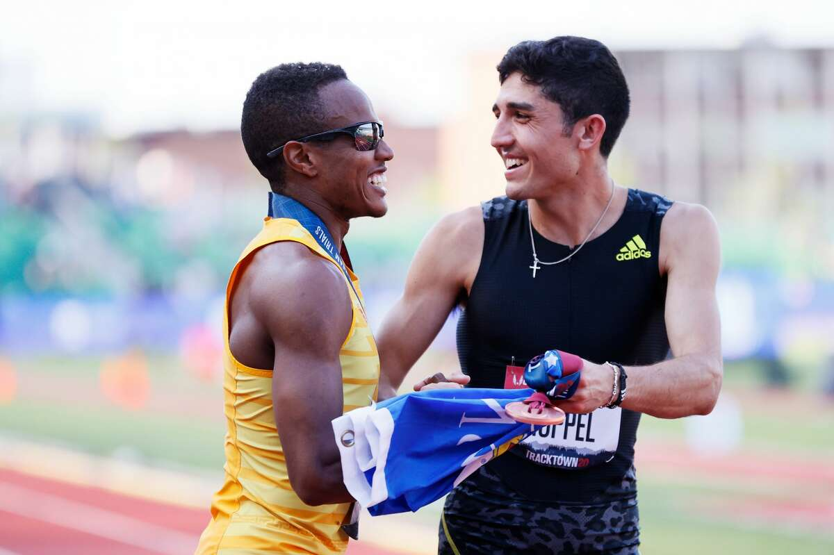 Isaiah Jewett and Bryce Hoppel celebrate after the Men's 800 Meters Final during day four of the 2020 U.S. Olympic Track & Field Team Trials at Hayward Field on June 21, 2021 in Eugene, Oregon. (Photo by Steph Chambers/Getty Images)