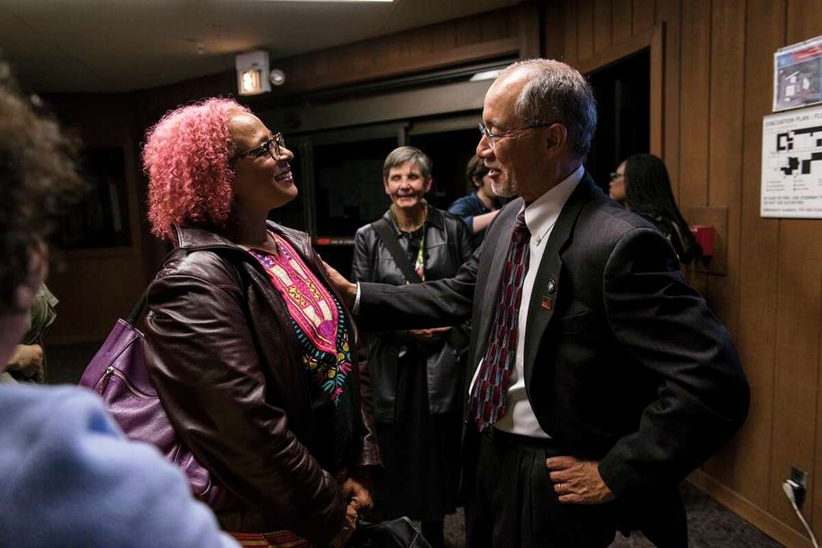 Peralta Community College District Trustee Nicky Gonzalez Yuen (right) speaks with Laney College psychology instructor Kimberly King during a Peralta board meeting in 2018.