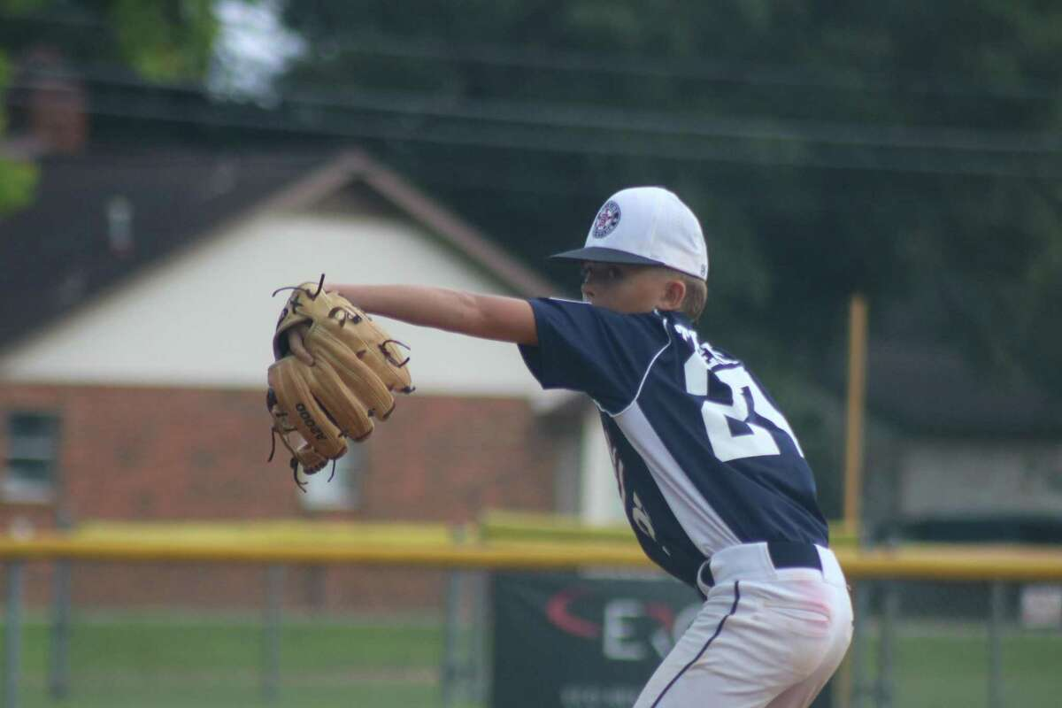 Bayside 12s hurler Torin Thiery works on a batter early in Monday night's game. He finished with a one-hitter, striking out eight.