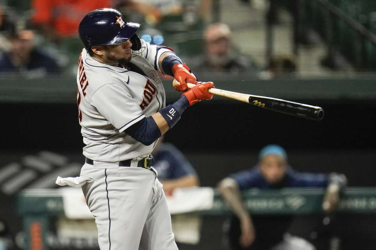 Houston Astros' Yuli Gurriel connects for a sacrifice fly ball to score Jose Altuve during the seventh inning of a baseball game against the Baltimore Orioles, Monday, June 21, 2021, in Baltimore. (AP Photo/Julio Cortez)
